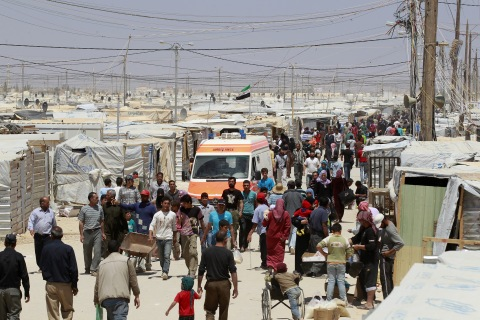 Syrian refugees walk at Al Zaatri refugee camp in the Jordanian city of Mafraq, near the border with Syria
