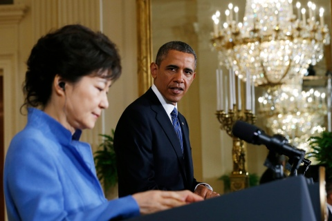 South Korea's President Park listens as U.S. President Obama addresses a joint news conference in the East Room of the White House in Washington