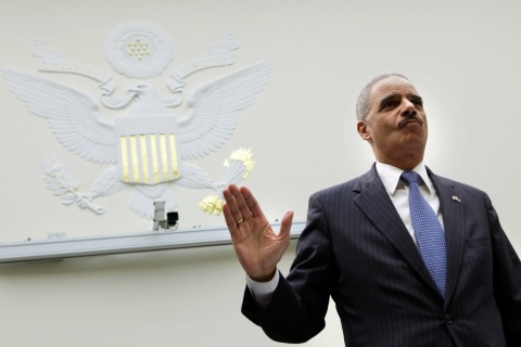 U.S. Attorney General Holder is sworn-in before a House Judiciary Committee hearing in Washington