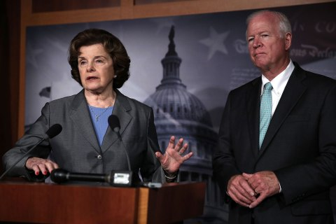 From left: Senator Dianne Feinstein and Senator Saxby Chambliss speak to members of the media about the NSA collecting phone records on Capitol Hill in Washington, D.C., on June 6, 2013.