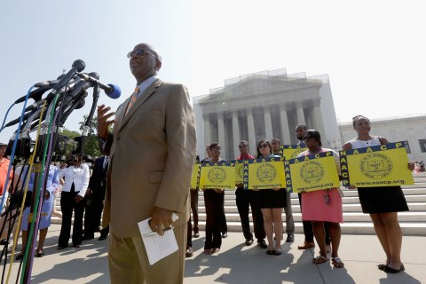 Field Director Charles White of the National Association for the Advancement of Colored People (NAACP) speaks at a podium outside the U.S. Supreme Court building, on June 25, 2013 in Washington, D.C.