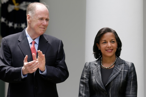 National Security Advisor Donilon applauds Rice after she was named to as his replacement in the White House Rose Garden in Washington