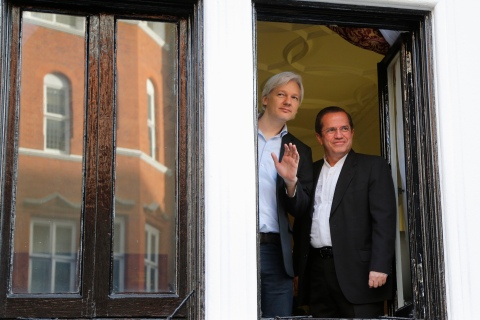 WikiLeaks founder Assange waves from a window with Ecuador's Foreign Affairs Minister Patino at Ecuador's embassy in central London