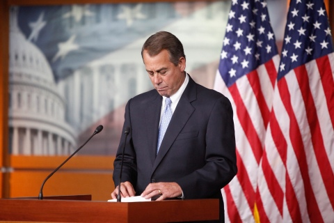 U.S. House Speaker  Boehner looks at his notes during a news conference at the U.S. Capitol in Washington