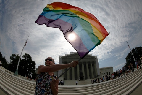 A gay marriage supporter waves a rainbow flag outside U.S. Supreme Court in Washington