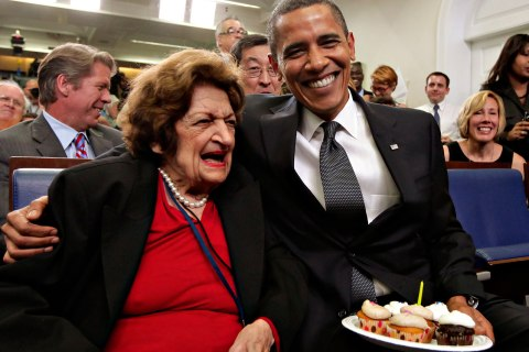 President Obama, marking his 48th birthday, takes a break from his official duties to bring birthday greetings to Helen Thomas, left, who shares the same birthday, in the White House Press Briefing Room in Washington, Aug. 4, 2009.