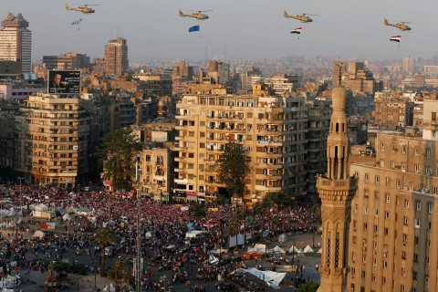 A view shows a fly-past over protesters against ousted Egyptian President Mursi in Tahrir Square in Cairo