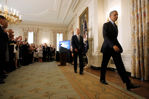 U.S. President Barack Obama leaves with Vice President Joe Biden after delivering remarks in White House in Washington