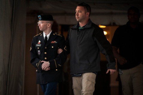 Manning is escorted out of court, after Judge Colonel Denise Lind announced she would read her verdict the next day, at Fort Meade