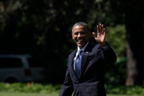 US President Obama smiles as he walks on the South Lawn of the White House in Washington