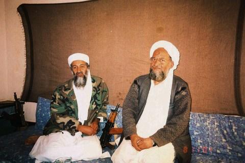 Osama bin Laden (L) sits with his adviser Ayman al-Zawahiri, an Egyptian linked to the al Qaeda netw..