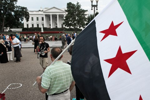 Protestors outside of the White House call for U.S. President Barack Obama to act on the reports of chemical-weapons use by Syrian President Bashar Assad against his own people, in Washington, D.C., on Aug. 21, 2013.