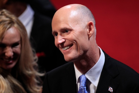 Florida Governor Scott greets an attendee in the audience before the start of the final U.S. presidential debate in Boca Raton
