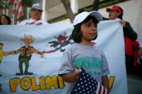 Maria Cervantes, 6, takes part in a 24-hour vigil calling on Congress to pass immigration reform in Los Angeles