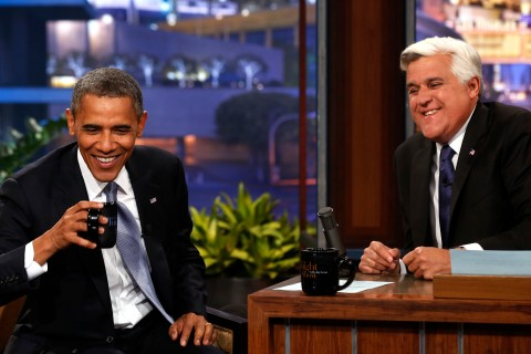 U.S. President Barack Obama sits next to Jay Leno during taping of comedy show in California