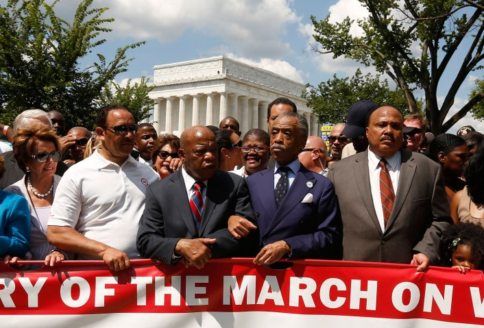 Rev. Al Sharpton, second right, links arms with Rep. John Lewis as they begin to march during the 50th anniversary of the 1963 March on Washington for Jobs and Freedom at the Lincoln Memorial in Washington Aug. 24, 2013.