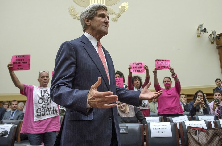 Secretary of State John Kerry arrives to address the House Foreign Affairs Committee and is confronted by protesters from Code Pink on Capitol Hill in Washington, Sept. 4, 2013.