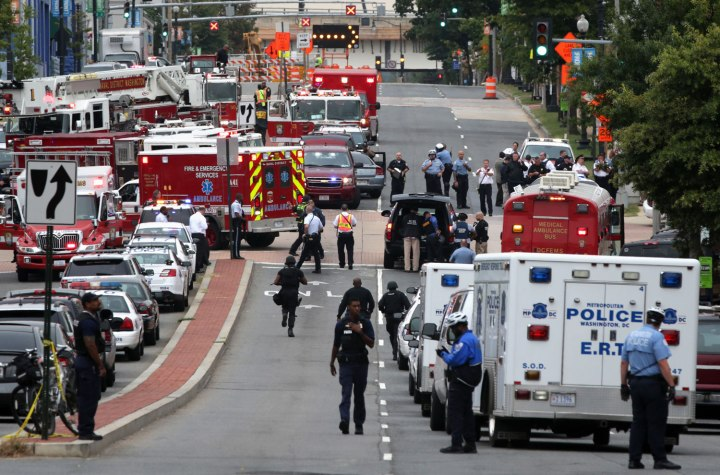 Emergency vehicles and law enforcement personnel respond to a reported shooting at an entrance to the Washington Navy Yard in Washington, D.C., on Sept. 16, 2013.