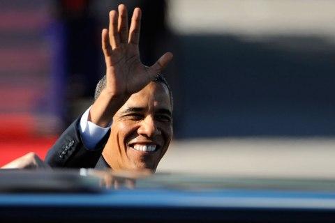 U.S. President Obama waves upon his arrival at Arlanda Airport in Stockholm