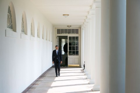 President Barack Obama walks along the colonnade of the White House from the residence to the Oval Office to start his day on September 10, 2013 in Washington.