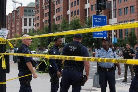 Police work the scene on M Street, SE in Washington, D.C., near the Washington Navy Yard, on Sept. 16, 2013.