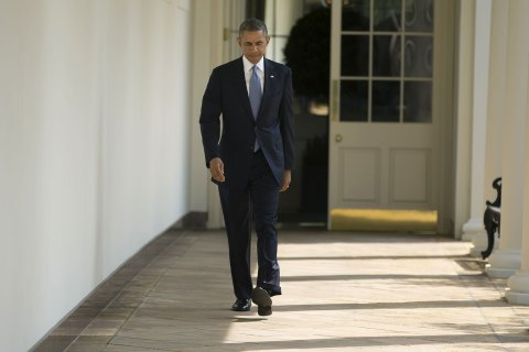 President Barack Obama walks along the West Wing Colonnade towards the Oval Office of the White House in Washington, Sept. 10, 2013, ahead of his daily briefing.