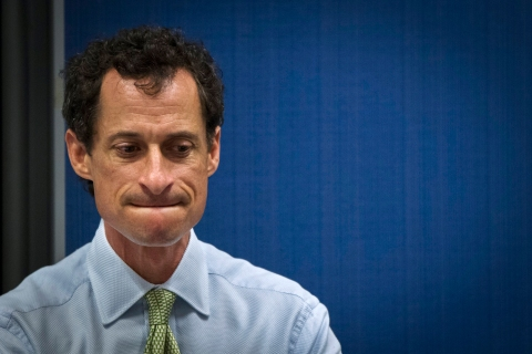 Candidate for New York City Mayor Weiner listens to fellow candidates at a debate in New York