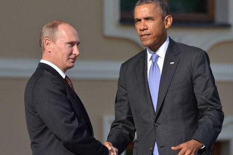 Russias President Vladimir Putin welcomes President Barack Obama at the start of the G20 summit on September 5, 2013 in Saint Petersburg.