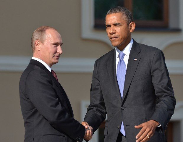 Russias President Vladimir Putin welcomes President Barack Obama at the start of the G20 summit on September 5, 2013 in Saint Petersburg.