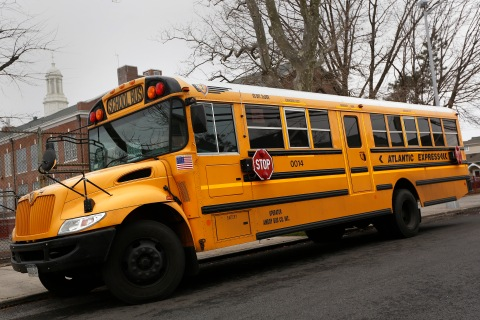 A school bus used for transporting New York City public school students is seen parked in front of a school in the Queens borough of New York