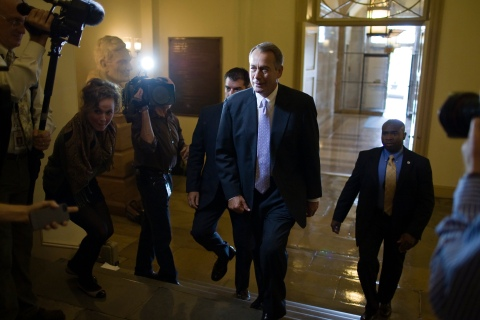 Boehner talks to reporters as he arrives at the U.S. Capitol in Washington