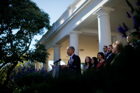 President Barack Obama, standing with supporters of his health care law, speaks in the Rose Garden of the White House in Washington, Monday, Oct. 21, 2013, on the initial rollout of the health care overhaul.