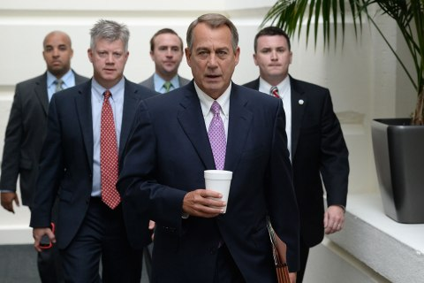 US Speaker of the House, Republican John Boehner, center,, walks to a meeting of House Republicans on the fourth day of a partial federal government shutdown, on Capitol Hill in Washington DC, Oct. 4, 2013.
