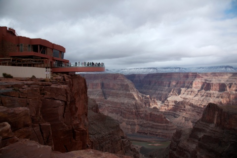 Visitors have a view of the Grand Canyon and the Colorado River flowing below from a skywalk extending out over the Grand Canyon and its incomplete building, on the Hualapai Indian Reservation Arizona
