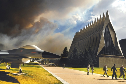 A cloud of smoke from the Waldo Canyon Fire rises from the south behind the Air Force Academy's Cadet Chapel evacuation procedures in Colorado Springs, on June 27, 2012 photograph released on July 1, 2012.
