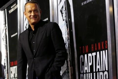 "Tom Hanks poses at the premiere of ""Captain Phillips"" at the Academy of Motion Picture Arts and Sciences in Beverly Hills"