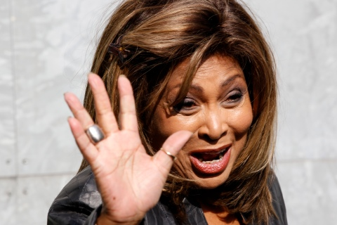 U.S. pop singer Tina Turner waves during photocall before the Emporio Armani  Autumn/Winter 2011 women's collection show at Milan Fashion Week