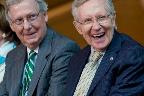 From left, Senate Minority Leader Mitch McConnell of Ky., and Senate Majority Leader Harry Reid of Nev., laugh during a ceremony to dedicate the statue of Frederick Douglass in the Emancipation Hall of the United States Visitor Center on Capitol Hill in Washington, Wednesday, June 19, 2013.