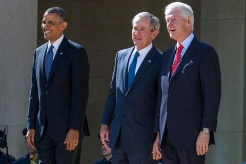 President Barack Obama stands with former presidents George W. Bush, Bill Clinton