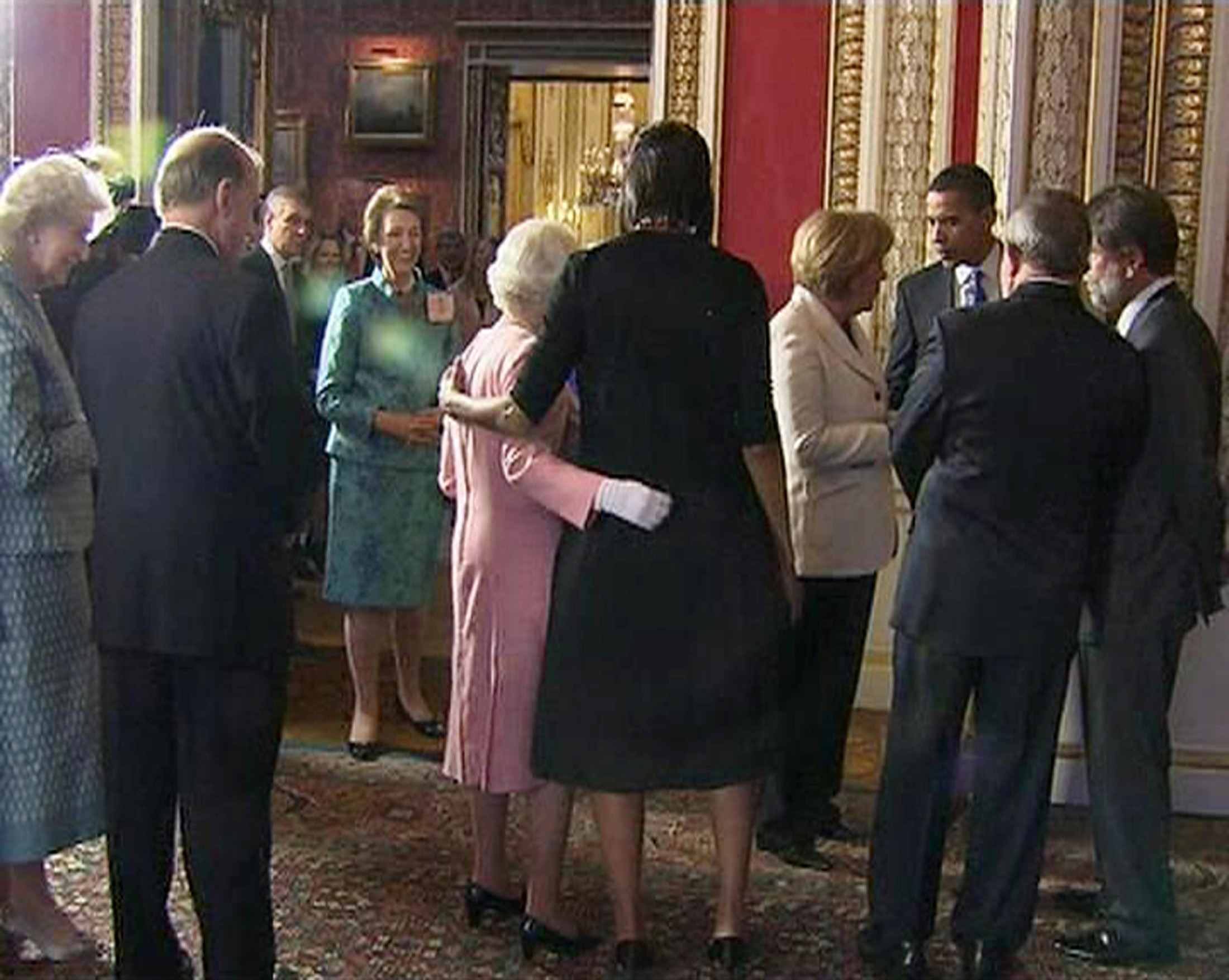 A video grab from television footage shows U.S. first lady Michelle Obama standing with Britain's Queen Elizabeth during a reception for G20 leaders at Buckingham Palace in London, April 1, 2009.