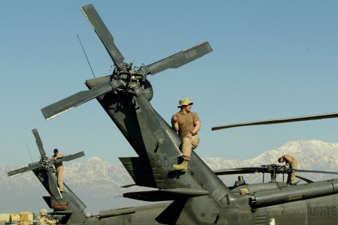 U.S. Army Soldier Works On MH-60 Blackhawk Helicopter