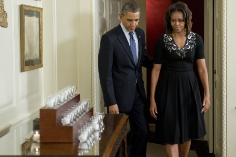 President Barack Obama and First Lady Michelle Obama arrive to light 26 candles honoring the 26 students and teachers killed at Sandy Hook Elementary School in Newtown, Conn., at the White House in Washington, December 14, 2013.