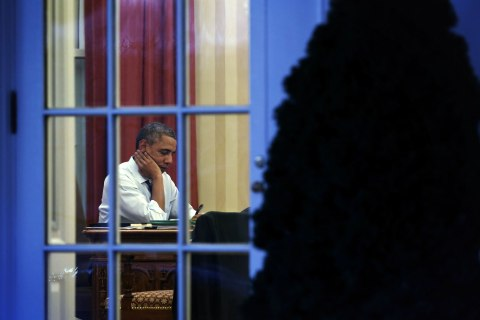 President Obama Works In The Oval Office At The White House