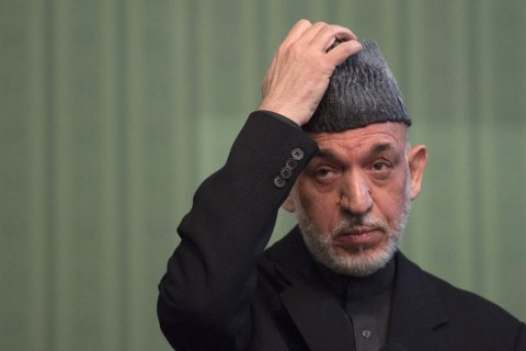 Afghan President Hamid Karzai gestures during a press conference at the Presidential Palace in Kabul on January 25, 2014.