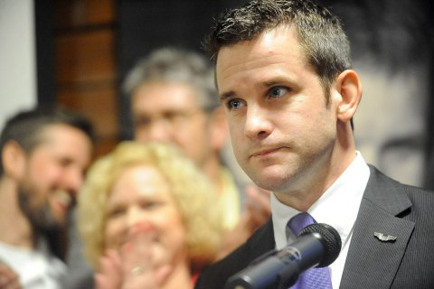 Republican Rep. Adam Kinzinger of Illinois speaks to the crowd at Starved Rock State Park Lodge and Convention Center in Utica, Ill.