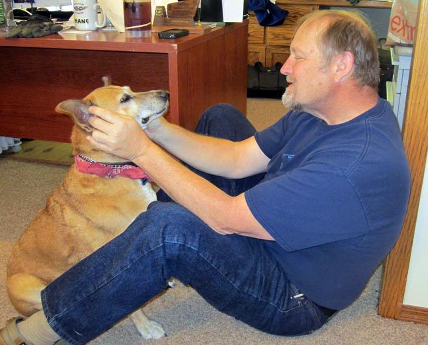 Shane Krogen plays with Susan's dog Weezee in Fresno, Calif., in Feb. 2013.