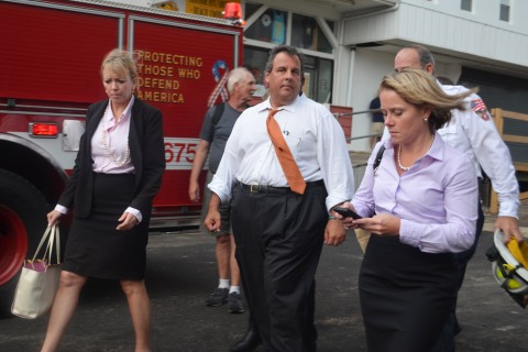 New Jersey Governor Chris Christie (center) and Deputy Chief of Staff Bridget Anne Kelly (right) walk at the scene of a boardwalk fire Sept. 12, 2013 in Seaside Heights, N.J.