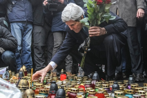 U.S. Secretary of State John Kerry lights a candle and lays roses atop the Shrine of the Fallen in Kiev